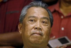 Former Malaysian Deputy Prime Minister Muhyiddin speaks to the media after he was sacked during a cabinet reshuffle in Kuala Lumpur