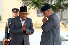 "Newly elected Nepalese PM Pushpa Kamal Dahal greets outgoing Prime Minister Khadga Prasad Sharma Oli (R) upon their arrival at the presidential building ""Shital Niwas"" in Kathmandu"