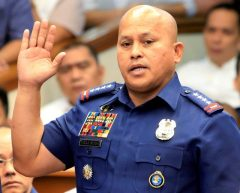 Philippine National Police (PNP) Director General Ronald Dela Rosa takes the oath during the start of a hearing investigating drug-related killings at the Senate headquarters in Manila
