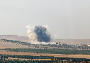 Smoke rises from the Syrian border town of Jarablus as it is pictured from the Turkish town of Karkamis