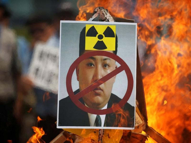A cut-out of North Korean leader Kim Jong-un is set on fire during an anti-North Korea rally in central Seoul, South Korea. Photo: Reuters/Kim Hong-ji