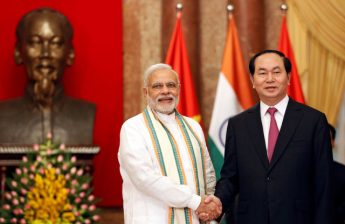 India's Prime Minister Narendra Modi poses for a photo with Vietnam's President Tran Dai Quang in front of a statue of late Vietnamese revolutionary leader Ho Chi Minh at the Presidential Palace in Hanoi, Vietnam
