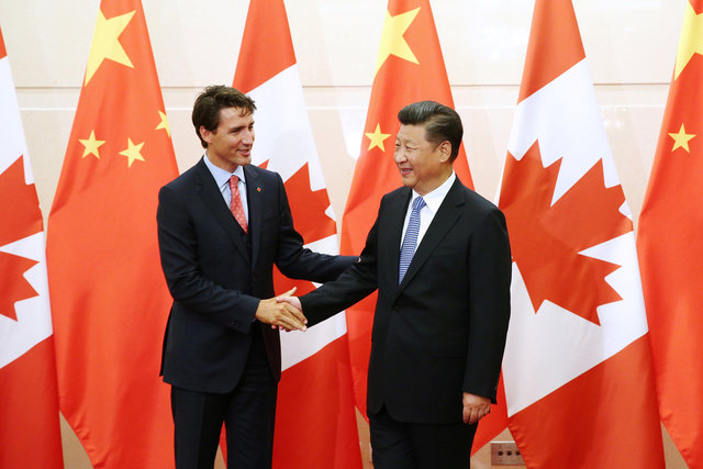 Chinese President Xi Jinping shakes hands with Canadian Prime Minister Justin Trudeau ahead of their meeting  in Beijing on August 31, 2016. Photo: Reuters/Wu Hong/Pool