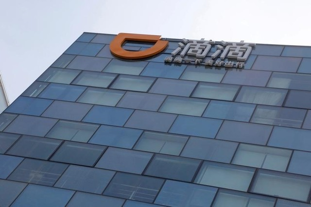 Logo of Didi Chuxing is seen at its headquarters building in Beijing, China, May 18, 2016. Photo: Reuters/Kim Kyung-Hoon