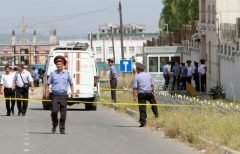 Investigators and Interior Ministry officers work near site of bomb blast outside China's embassy in Bishkek