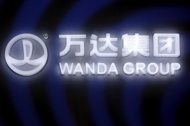A sign of Dalian Wanda Group in China glows in Beijing, China March 21, 2016. Photo: Reuters/Damir Sagolj