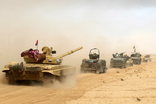 Iraqi forces deploy on October 17, 2016 in the area of al-Shurah, some 45 kms south of Mosul, as they advance towards the city to retake it from the Islamic State (IS) group jihadists. Photo: AFP