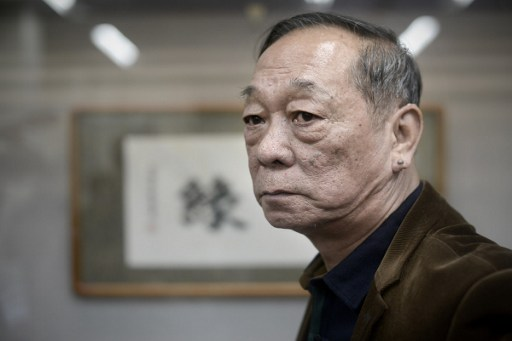 Jin Yulan, the nephew of China's last emperor Pu Yi, attends his private antique  show in Beijing. Photo: Agence France-Presse/ Wang Zhao