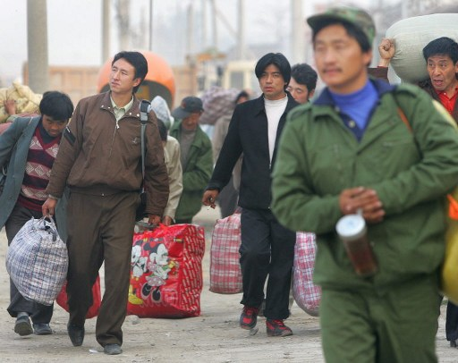 Sent packing. China plans to lay off 500,000 heavy industry workers. Photo: AFP