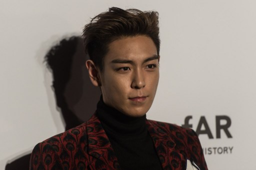 South Korean singer and actor T.O.P. curated a Sotheby's auction in Hong Kong last week. AFP PHOTO / ANTHONY WALLACE