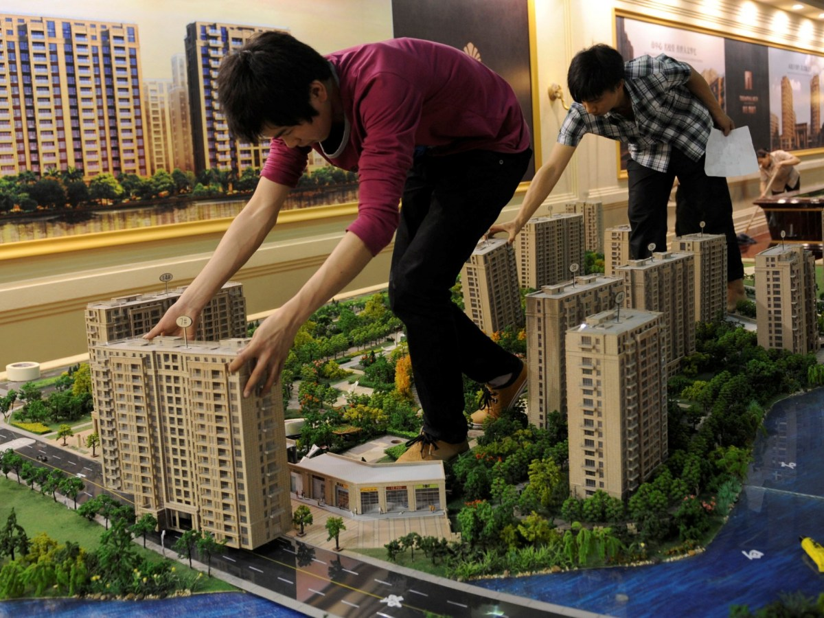 Employees set up model apartments as they prepare a real estate exhibition in Hangzhou, Zhejiang province. Photo: Reuters