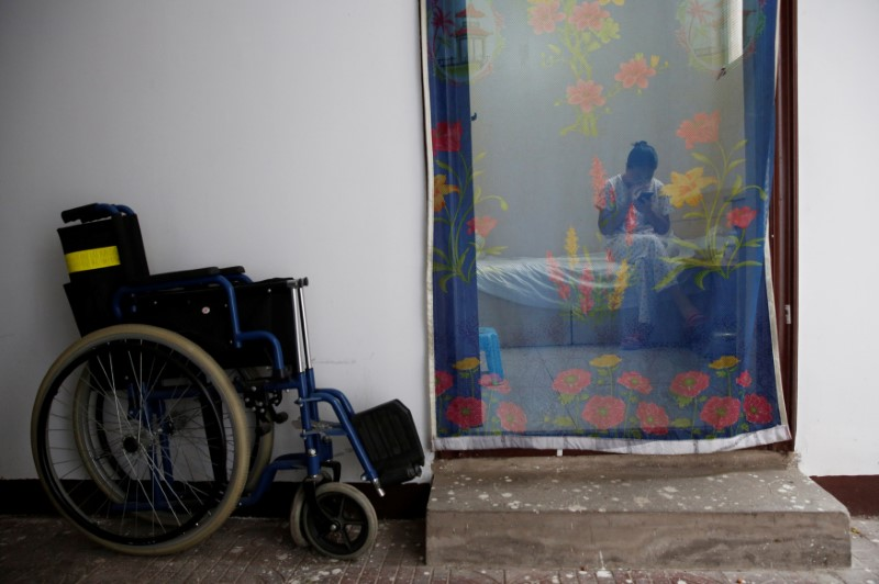 Woman in accomodation next to hospital where patients and their families stay while seeking medical treatments in Beijing, China, June 23, 2016. Reuters/Kim Kyung-Hoon