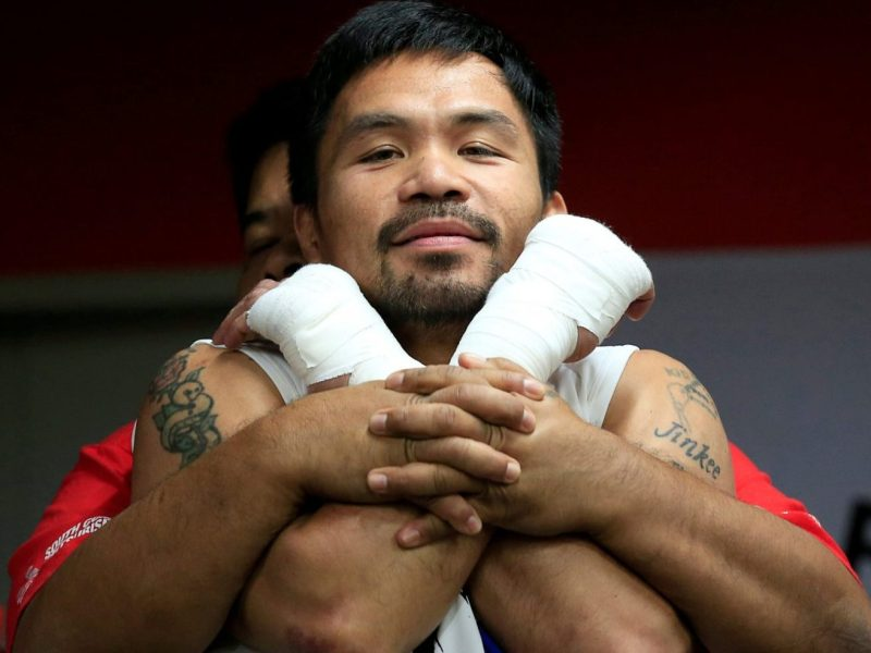 Senator and boxing champion Manny Pacquiao stretches during his training inside the Elorde gym in Pasay City, metro Manila, Philippines September 28, 2016 in preparation for his upcoming bout with Jessie Vargas in Las Vegas. Picture taken September 28, 2016. REUTERS/Romeo Ranoco