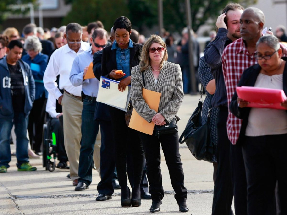 People wait in line to enter a job fair in Uniondale, New York. Photo: Reuters/Shannon Stapleton