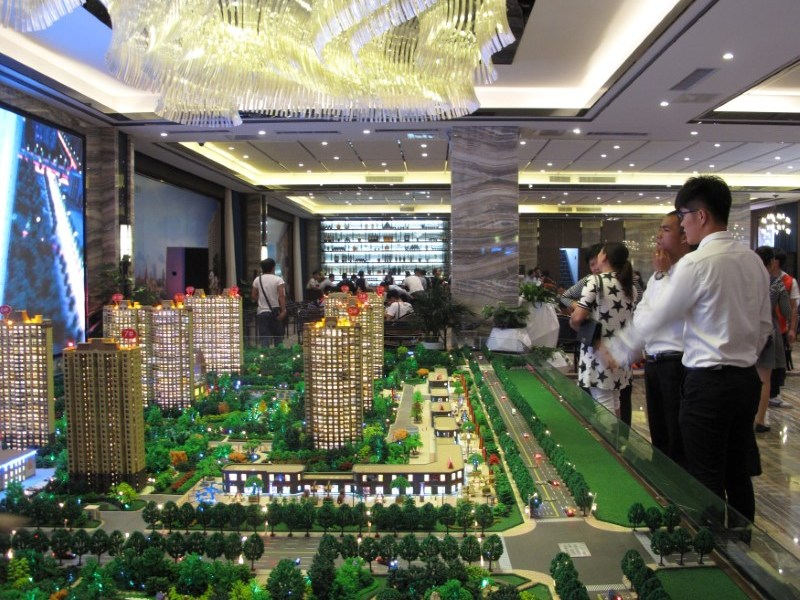 Models of residential buildings are seen at a sales center in Zhengzhou, Henan province, China.  Photo: REUTERS/Yawen Chen