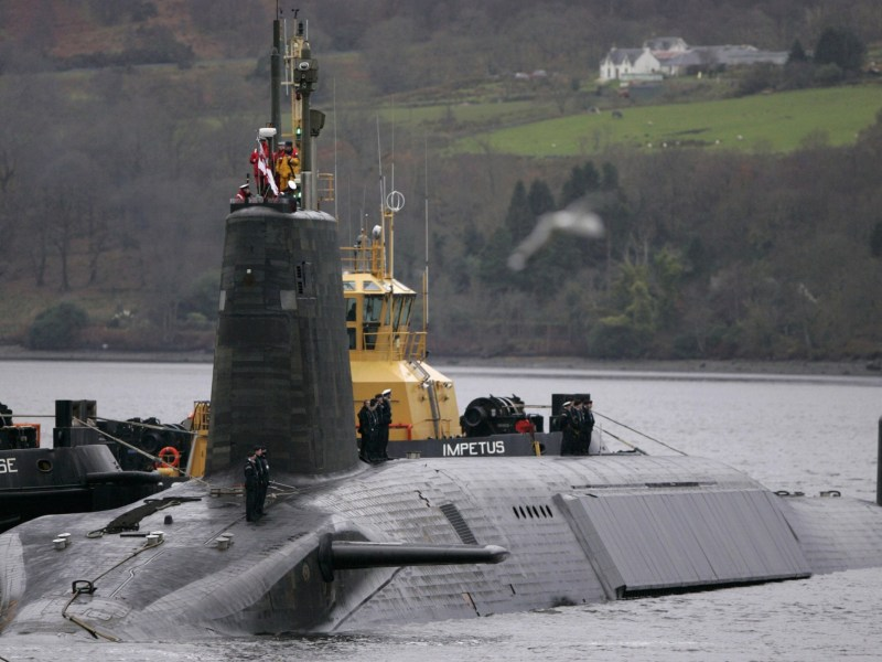 Crew from HMS Vengeance stand on their vessel as they return along the Clyde river to the Faslane naval base near Glasgow. Photo: REUTERS/David Moir
