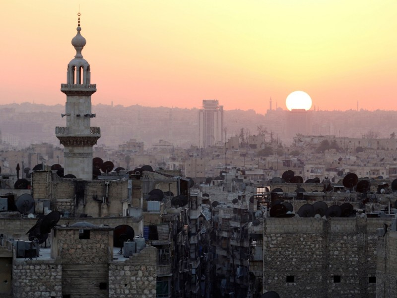 The sun sets over Aleppo. Photo: Reuters / Abdalrhman Ismail