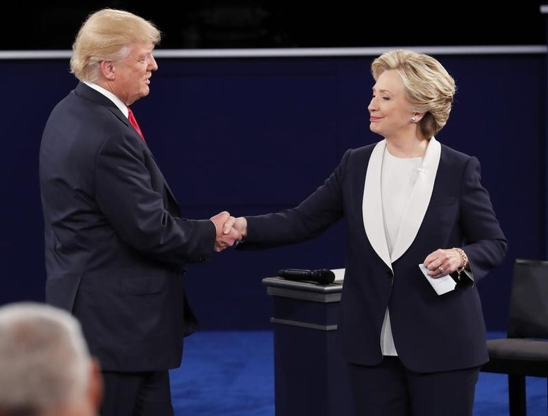 Republican US presidential nominee Donald Trump and Democratic US presidential nominee Hillary Clinton shake hands at the end of their presidential town hall debate at Washington University in St. Louis, Missouri, US, October 9, 2016.  Photo: Reuters/Jim Young