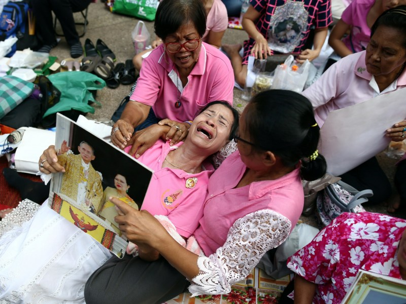Well-wishers weep as they pray for Thailand's King Bhumibol Adulyadej at the Siriraj hospital where he died on October 13 in Bangkok, Thailand. Reuters, Athit Perawongmetha