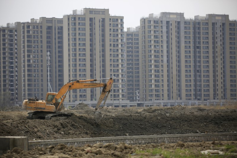 An excavator at work on a construction site of new residential buildings in Shangha. Reuters