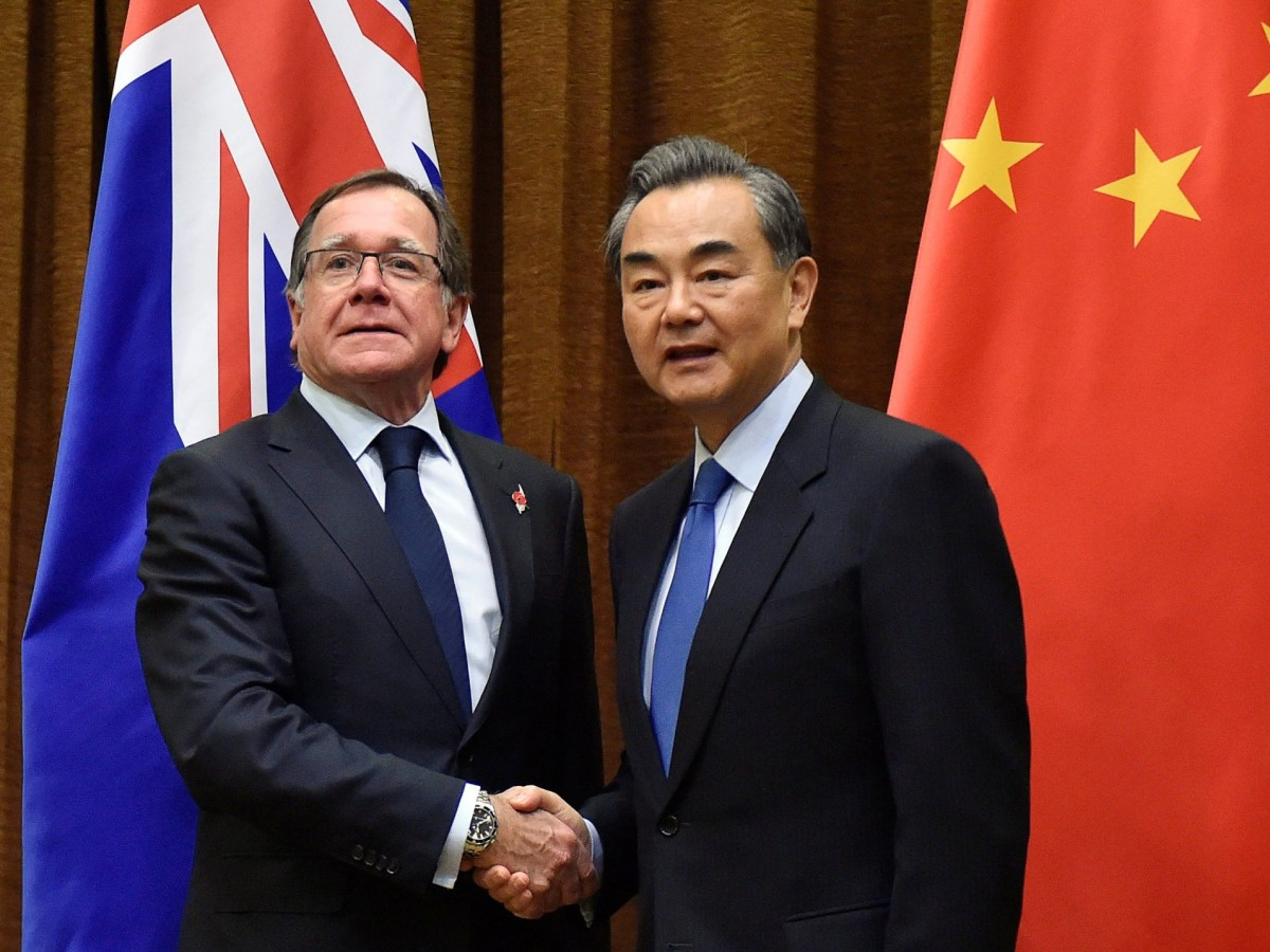 The long arm of China: Murray McCully, Foreign Minister of New Zealand shakes hands with Wang Yi, Foreign Minister of China ahead of their meeting in Beijing in October 2016. Photo: Reuters/ Kenzaburo Fukuhara