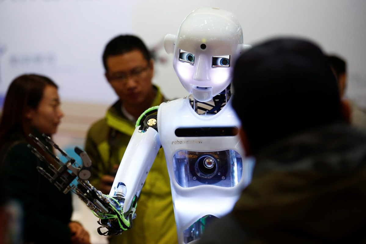 To be, or not to be. That is the question! A RoboThespian humanoid robot engages an audience at the Tami Intelligence Technology stall at the World Robot Conference in Beijing. Photo: Reuters/Thomas Peter