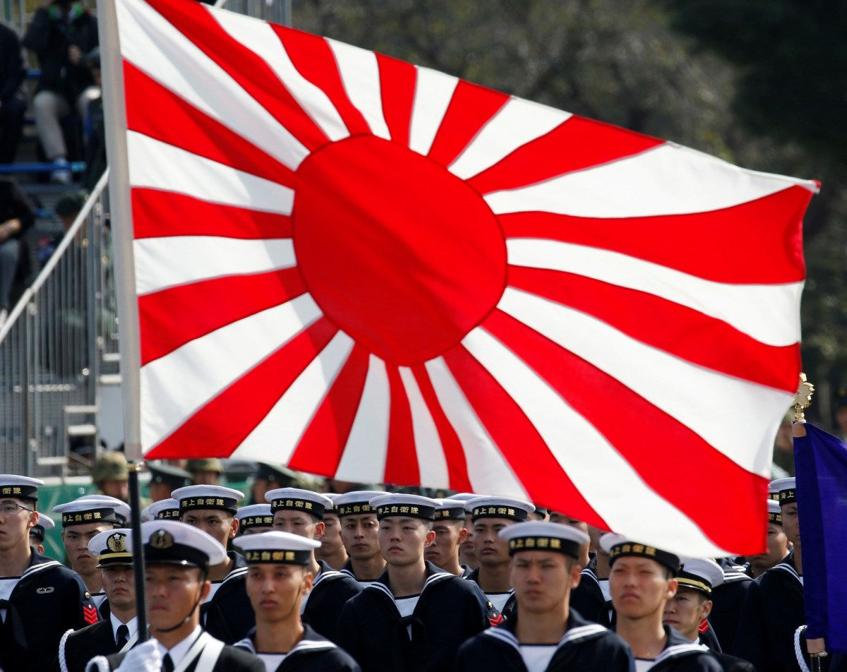 Members of Japan's Maritime Self-Defense Forces' infantry unit stand to attention. Photo: Reuters/Kim Kyung-hoon