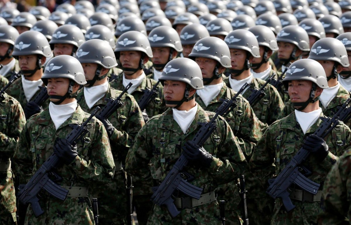 Members of Japan's Self-Defence Forces' airborne troops stand at attention during the annual SDF ceremony at Asaka Base. Photo: REUTERS/Kim Kyung-Hoon