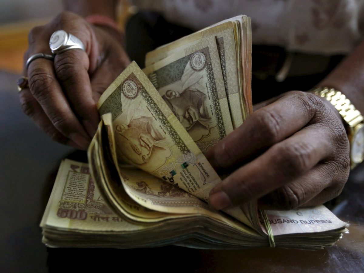 Money lender counting Indian rupee currency notes. Photo: Reuters/Amit Dave/File photo