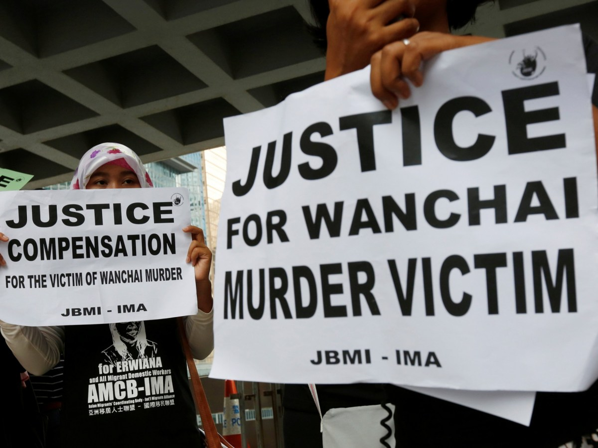 Members from a migrant workers' group protest outside the High Court in Hong Kong, where former British banker Rurik Jutting is on trial for the murder of two Indonesian women. Photo: Reuters/Bobby Yip