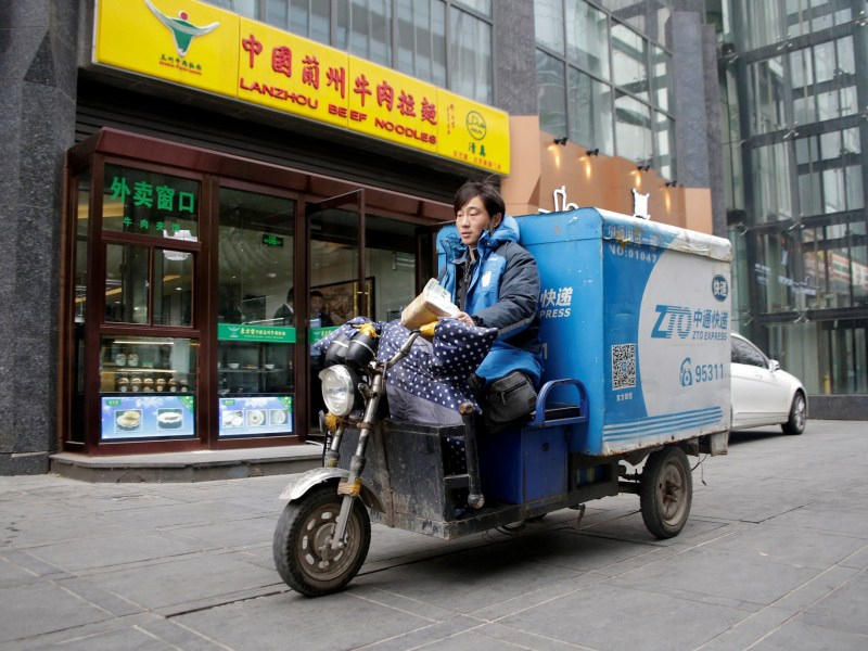 Chinese package company ZTO Express raised US$1.4 billion in its IPO in New York. Photo: Reuters/Thomas Peter