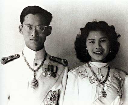 Bhumibol and his bride Queen Sirikit seen here at their wedding in April 1950. Three years earlier, his uncle Prince Rangsit, had authorized a military coup and signed the 1949 constitution.