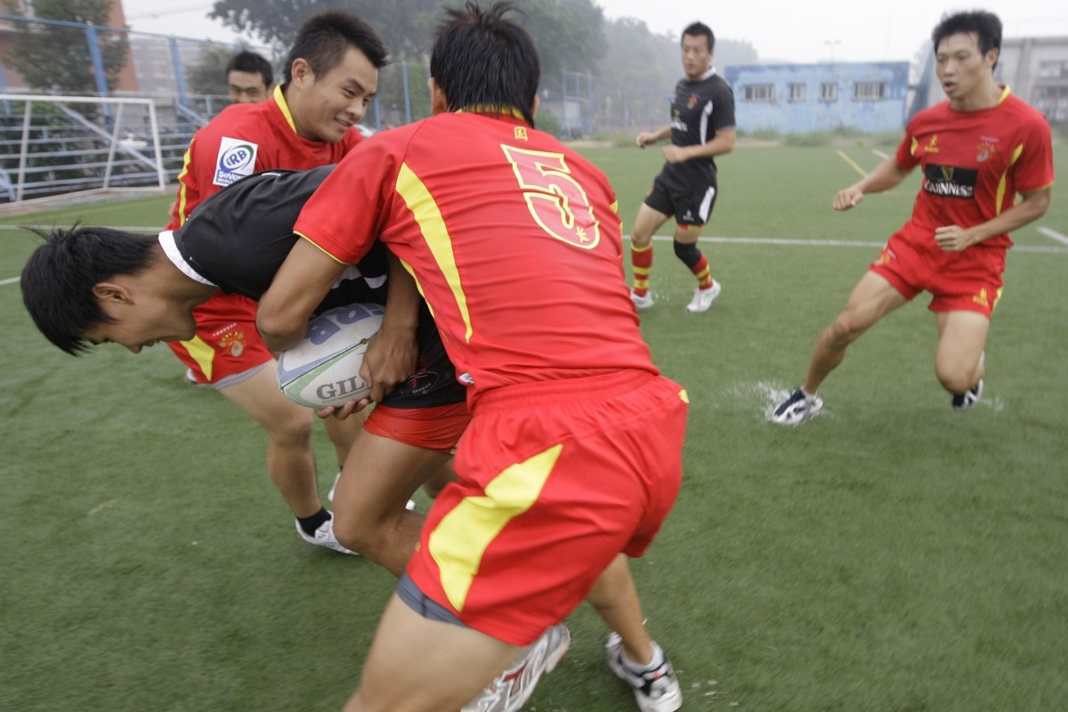 Members of the Chinese national rugby team in a practice session at the China Agricultural University in Beijing. Fewer than 80,000 Chinese currently play rugby. Photo: Reuters/Jason Lee