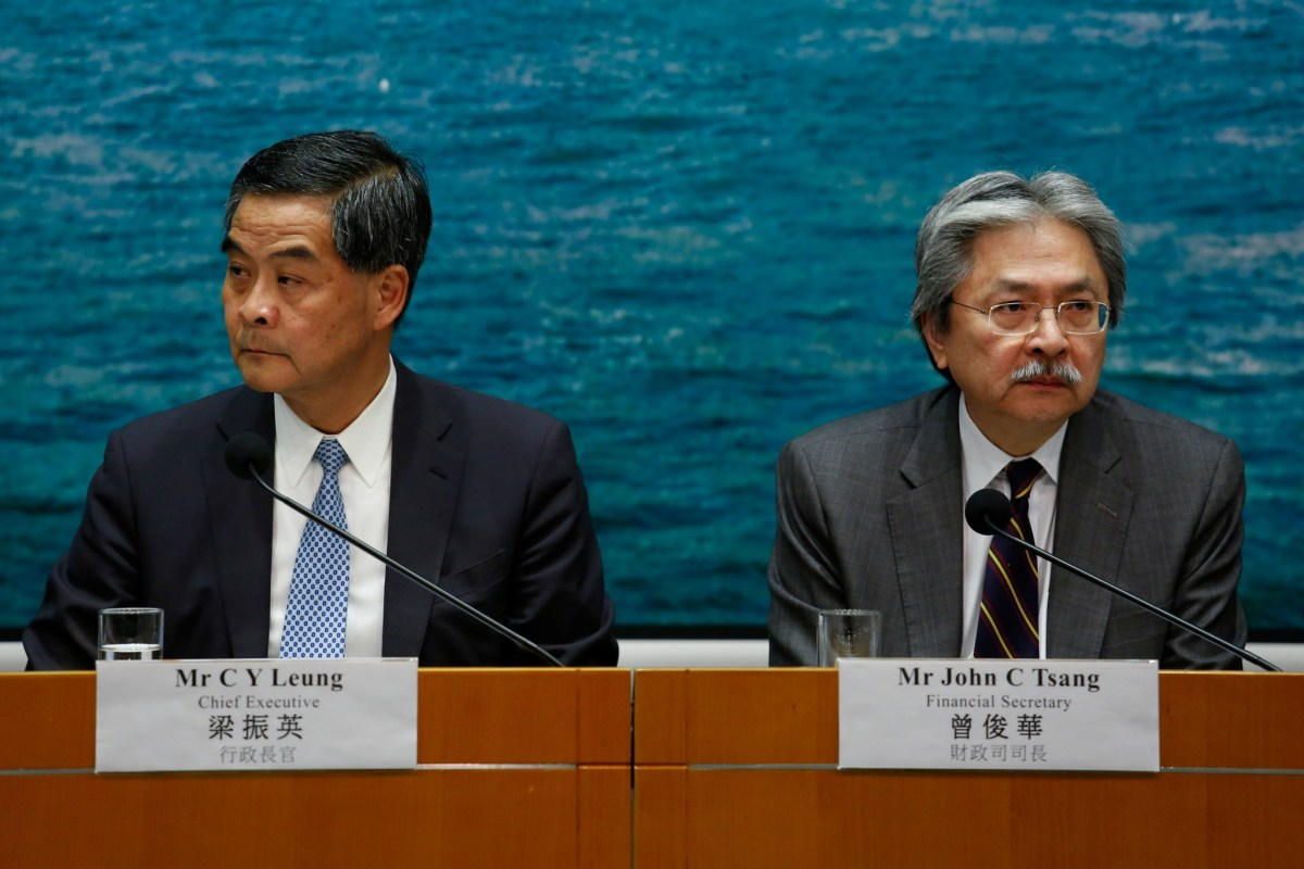 Hong Kong Chief Executive Leung Chun-ying (L) and Financial Secretary John Tsang attend a news conference held to clarify the decision on scaling down a housing project in Hong Kong, China September 21, 2016. REUTERS/Bobby Yip