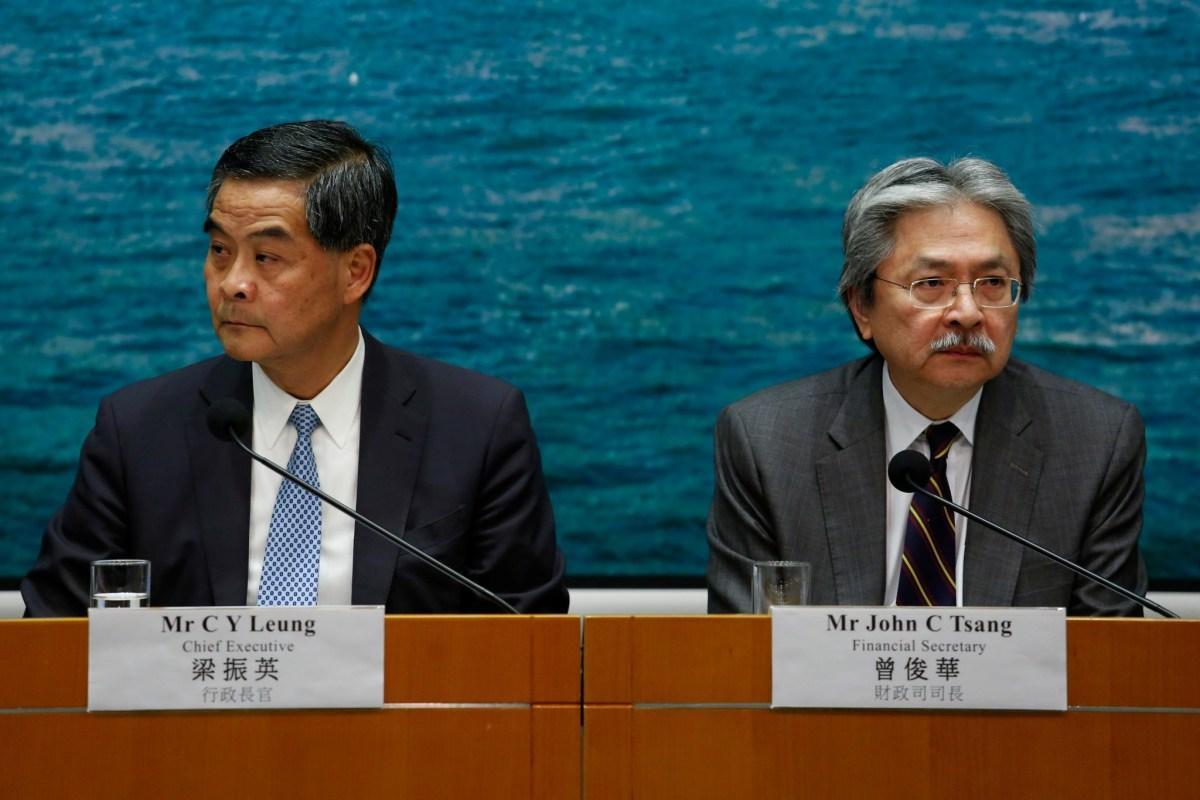 Hong Kong Chief Executive Leung Chun-ying (L) and Financial Secretary John Tsang attend a news conference held to clarify the decision on scaling down a housing project in Hong Kong, China September 21, 2016. REUTERS/Bobby Yip