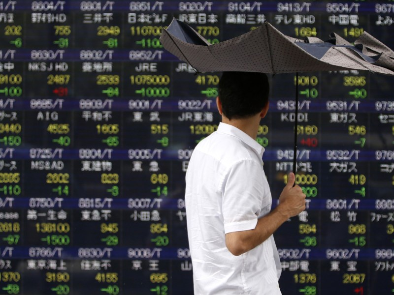 MSCI's broadest index of Asia-Pacific shares outside Japan,  .MIAPJ0000PUS, was barely in the black. Photo: Reuters / Yuya Shino