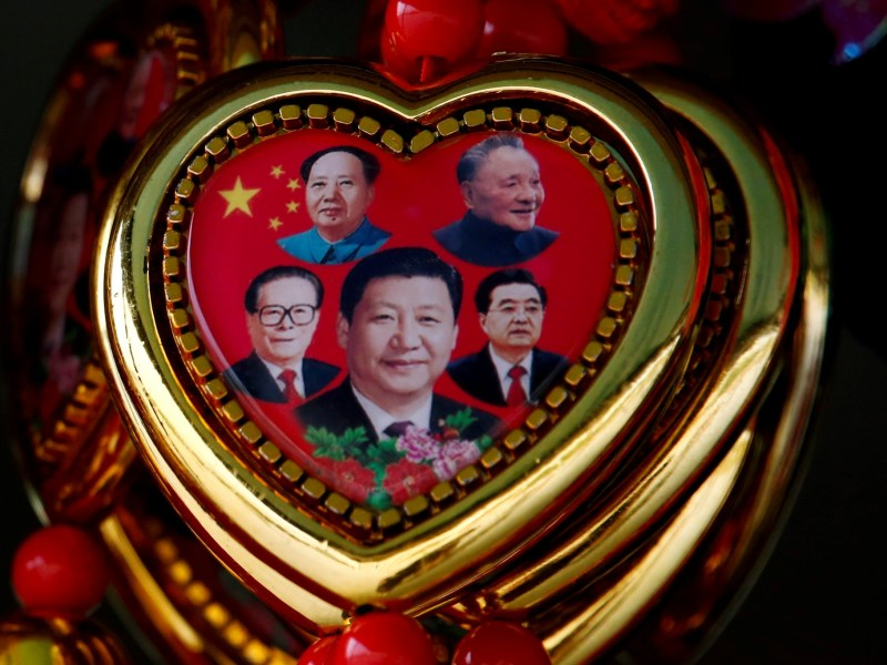 Deng Xiaoping (top right)  had his eponymous 'Theory' written into the constitution after his death. Xi Jinping Thought has been enshrined while he is still in office. Photo: Reuters / Thomas Peter