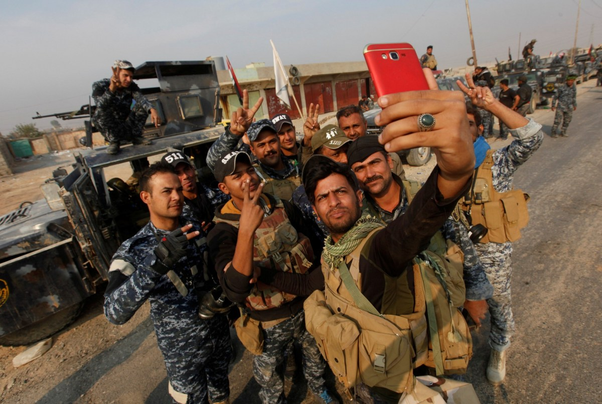 Federal police take a selfie in Qayyara, south of Mosul. Photo: REUTERS/Alaa Al-Marjani