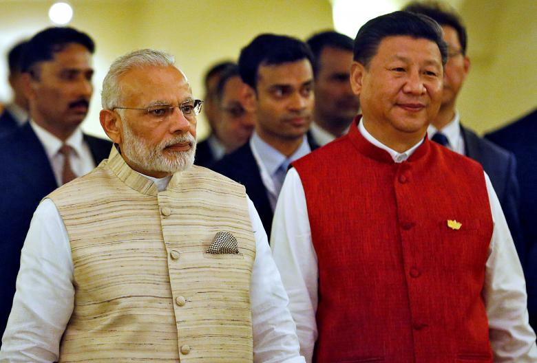 Indian Prime Minister Narendra Modi (L) and Chinese President Xi Jinping  arrive for a photo opportunity ahead of BRICS (Brazil, Russia, India, China and South Africa) Summit in Benaulim, in Goa, India, October 15, 2016. REUTERS/Danish Siddiqui