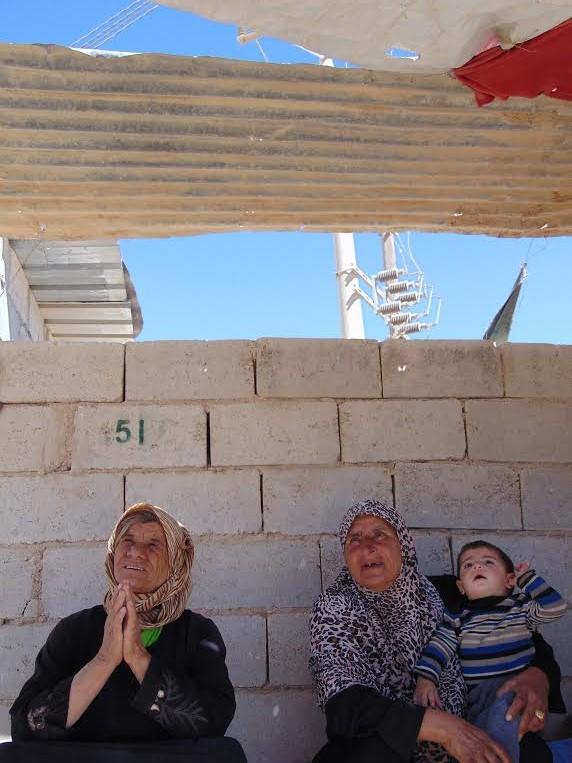 Syrian women waiting for a bus outside Zaatari refugee camp. Photo: Manish Rai