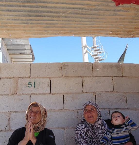 Syrian women waiting for a bus outside Zaatari refugee camp. Photo: Manish Rai