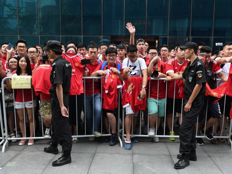 Fans of Manchester United wait outside the team's hotel in Beijing, in July, after a match due to be held in the Chinese capital against Manchester City was canceled. Photo: GREG BAKER / AFP