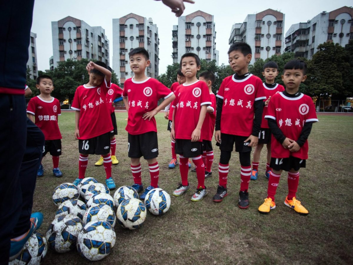 Children attend a football training session in the suburbs of Guangzhou, Guangdong province. File photo from Nov 2016 by AFP/ Johannes Eisele