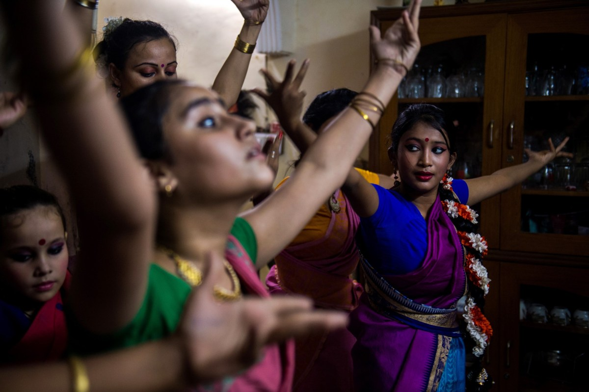 Dance students perform a Bharatnatyam dance under the tutelage of Aayurshi Neeraj in New Delhi. Photo: AFP / Chandan Khanna