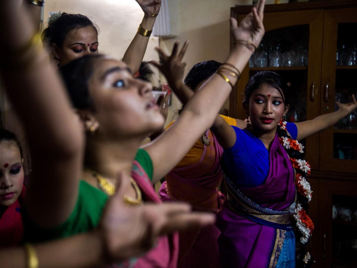 Dance students perform a Bharatnatyam dance under the tutelage of Aayurshi Neeraj in New Delhi. Photo: AFP / Chandan Khanna