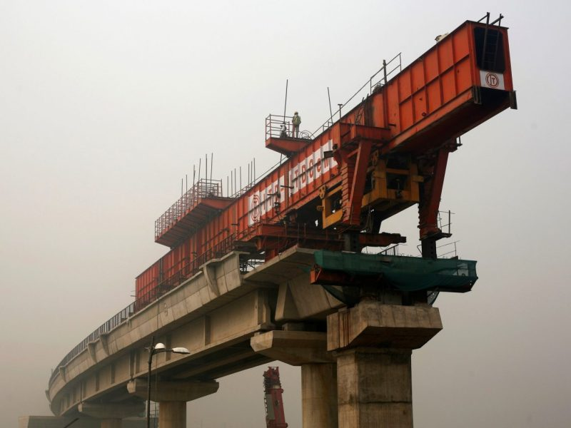 Construction of the metro rail line in New Delhi has been one of the biggest sources of pollution and smog. Photo: Reuters, Adnan Abidi (Nov 2, 2016).