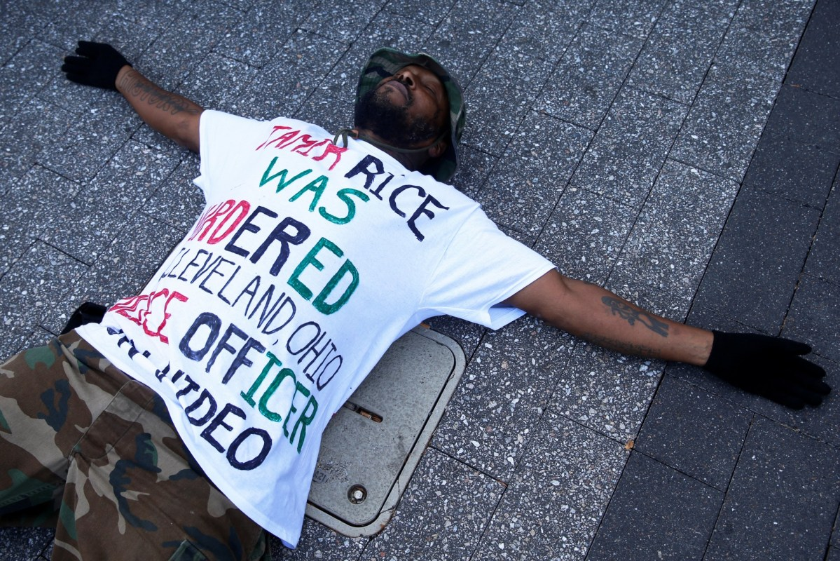 Stevedore Crawford Jr. lies on the ground during a Black Lives Matter rally in Columbus, Ohio US, October 28, 2016. Photo: REUTERS/Shannon Stapleton