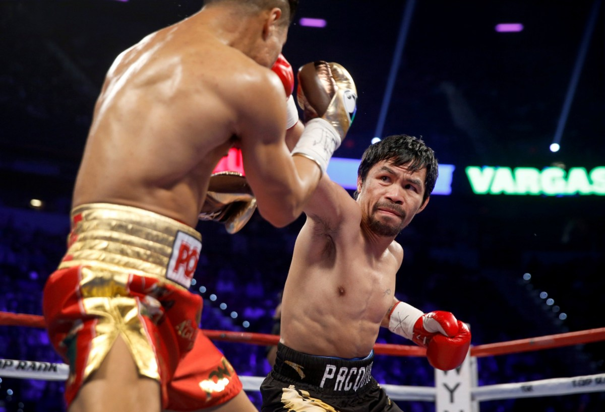 Manny Pacquiao connects with Jesse Vargas on his way to securing the WBO title for a third time.