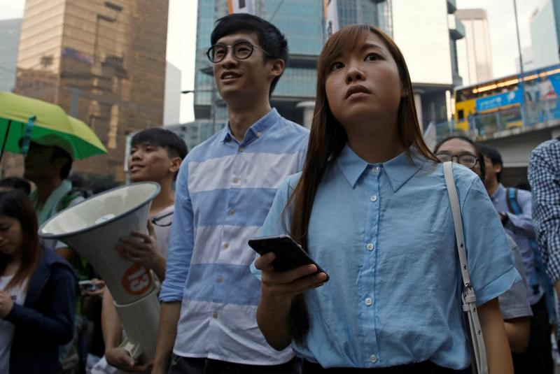 Baggio Leung and Yau Wai-ching were elected last year after campaigning for autonomy for Hong Kong. However, they were ultimately barred from taking their seats in the city's Legislative Council. Photo: Reuters/Tyrone Siu