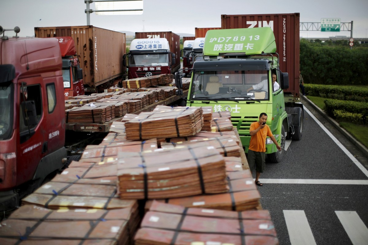 Trucks carrying copper and other goods wait to enter an area of the Shanghai free trade zone. Photo: Reuters/Carlos Barria